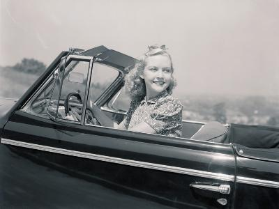Blonde Woman Driving a Convertible