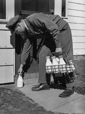 Milkman Leaving Milk Bottle on Doorstep