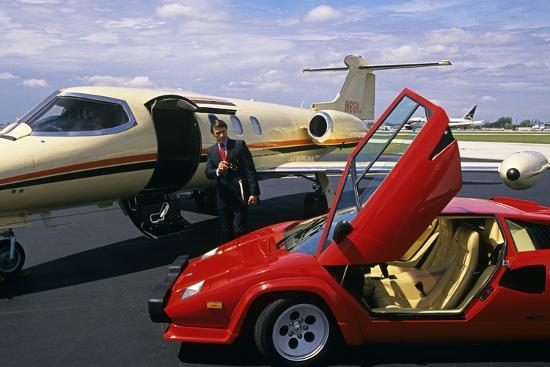 Successful Wealthy Businessman With Lamborghini And Jet Plant