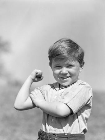 1930s Boy Making Strong Muscle Flexing Arm