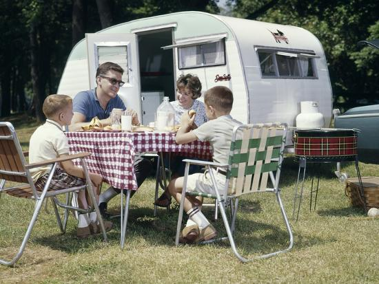 S Family Sitting In Lawn Chairs At Picnic Table Beside Camping - Picnic table trailer