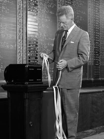 1950s-1960s Stock Broker Reading Quotation Tape at Office Ticker-Tape  Machine on Exchange' Photographic Print | AllPosters.com
