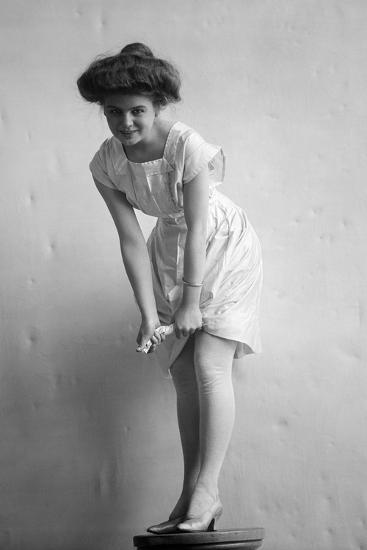1900s-1910s Woman with Gibson Girl Hair Style Ringing Out Wet Chemise  Hemline