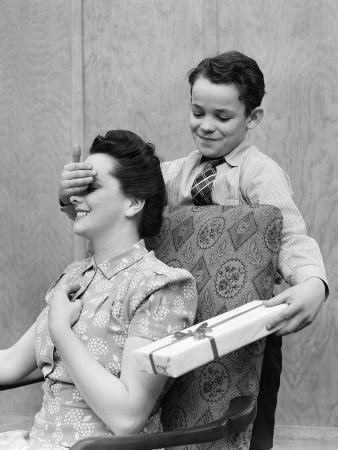 1930s-1940s Boy Son Surprising Woman Mother with Gift Wrapped Present