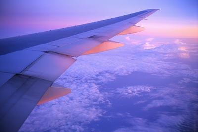 Setting Sun Hitting Airplane Wing
