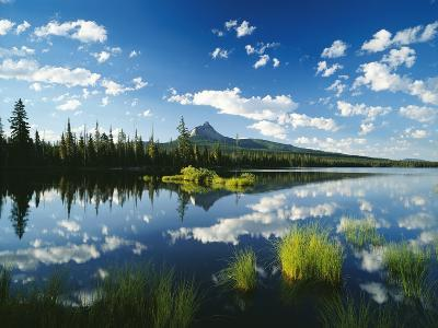 Clouds in Sky Reflected by Mountain Lake