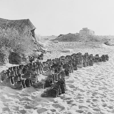 Rubber Soled Shoes in Rows on Beach