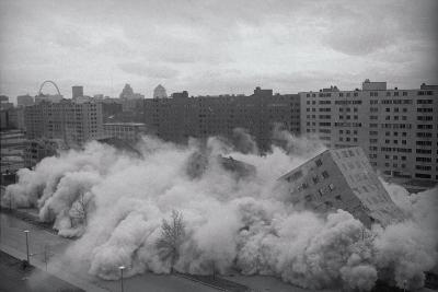 Building Complex falling amidst Dust
