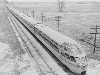 Streamlined Train Cars on Daytime Schedule