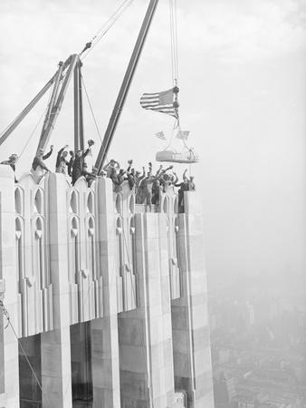 Workers Placing Last Stone on RCA Building