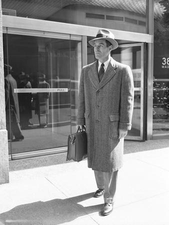 Salesman Leaving Madison Avenue Office