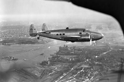 Howard Hughes Lockheed 14 Super Electra over New York City