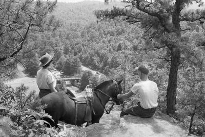 Horseback Riders Rest to Admire View