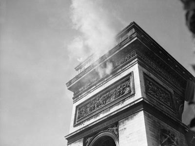 Smoke from Snipers atop Arc De Triomphe