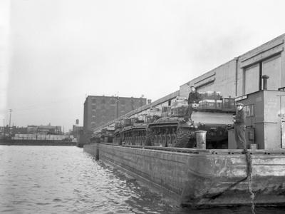 Military Tanks Being Loaded onto a Barge