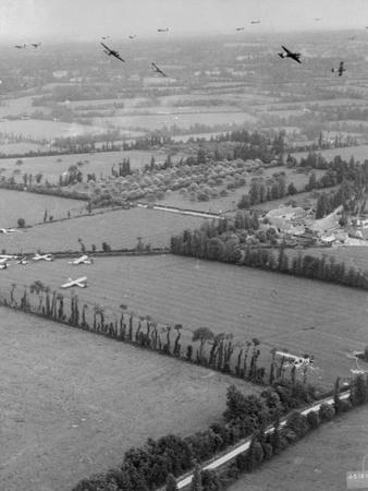 Aerial View of Planes Flying over Fields