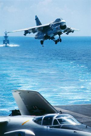 US Navy Corsair Jet Preparing for Landing on Carrier