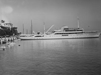 Onasis Yacht Docked near Shore