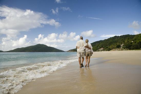 Middle Aged Walking On Lambert Beach Tortola British Virgin Islands