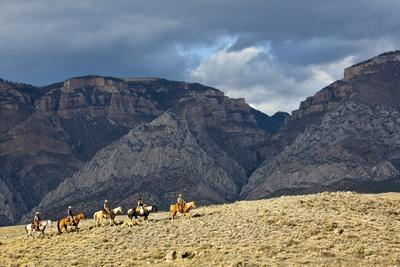 Cowboys and Cowgirls Riding along the Hills of the Big Horn Mountains