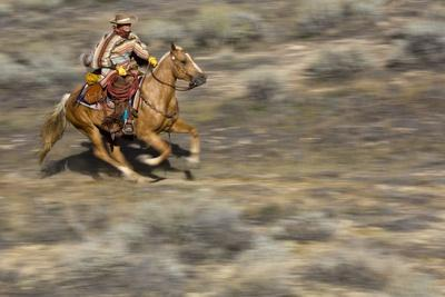 Cowgirl Riding at Full Speed in Motion