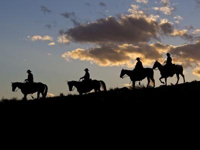Cowboys in Silhouette with Sunset
