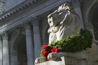 New York Public Library Lion Decorated with a Christmas Wreath during the Holidays.