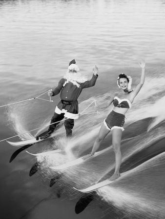 Santa Claus Water Skiing with Female Friend