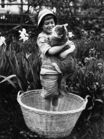 Girl (6-7 Years) Embracing Her Cat