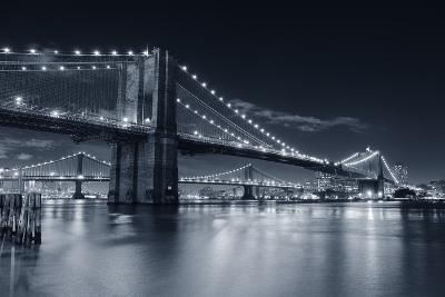 Brooklyn Bridge Over East River At Night In Black And White In New York City Manhattan