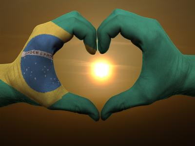 Heart And Love Gesture By Hands Colored In Brazil Flag During Beautiful Sunrise