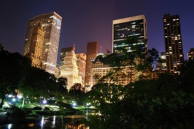 New York City Central Park at Night with Manhattan Skyscrapers Lit with Light.