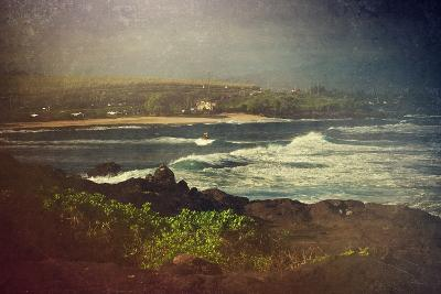 Surfer on a Waverunner in the Water at Hookipa Beach in Maui with the West Maui Mountains