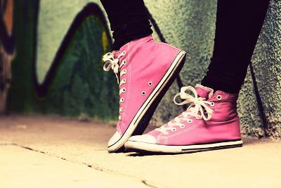 Close up of Pink Sneakers Worn by a Teenager. Grunge Graffiti Wall, Concepts of Teen Rebel, Problem