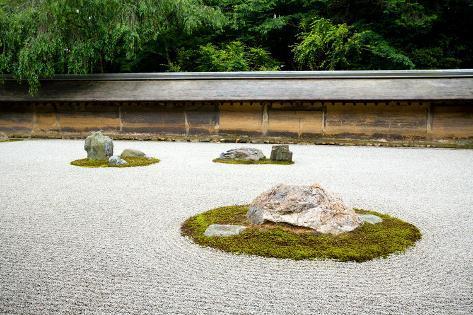A Zen Rock Garden In Ryoanji Temple.In A Garden Fifteen Stones On White  Gravel. Kyoto.Japan.
