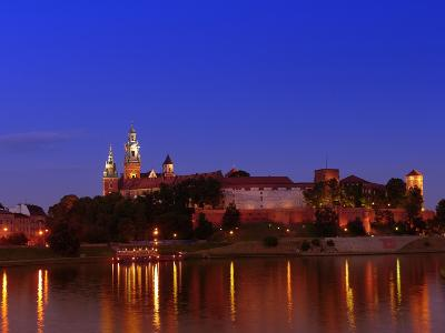 Royal Wawel Castle Illuminated at Night Reflecting in the Vistula River, Krakow - Poland