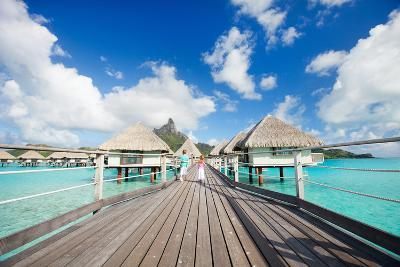 Two Kids Walking towards over the Water Bungalowas