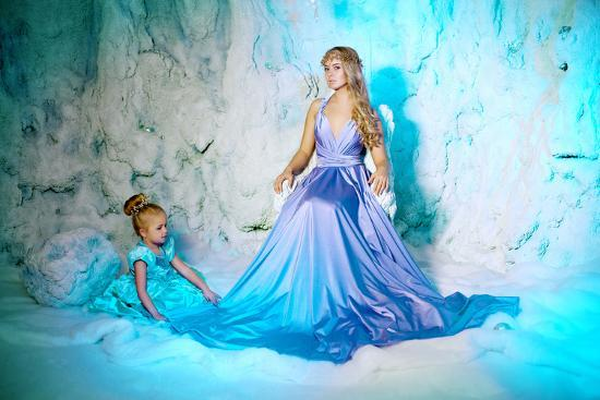 e0dc596b88e15 Little Girl with Mother in Princess Dress on a Background of a Winter Fairy  Tale. Baby and Mom Snow Photographic Print by Miramiska at AllPosters.com