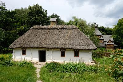 White Traditional Ukrainian Rural Wooden House with Hay Roof ,Luga Village,Podillya,Europe