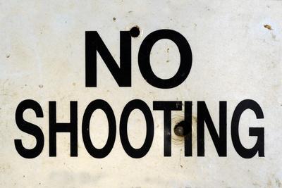 Damaged No Shooting Sign
