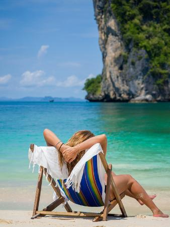 Woman Relaxing on the Beach on a Sunbed in Thailand
