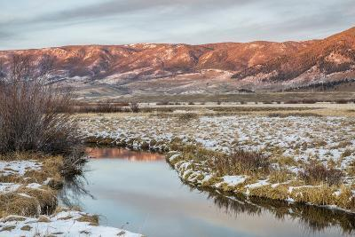 Dusk over Canadian River and Medicine Bow Mountains in North Park near Walden, Colorado, Late Fall
