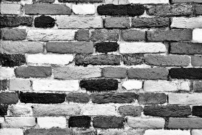 Black and White Brick Wall of Many Shades. Unique Background, Pattern.
