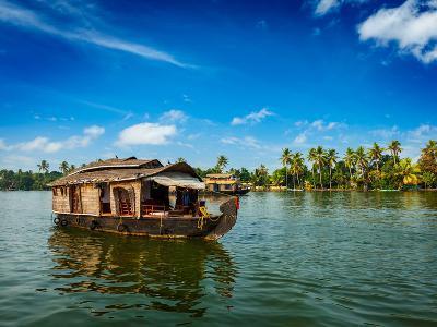 Travel Tourism Kerala Background - Houseboat on Kerala Backwaters. Kerala, India