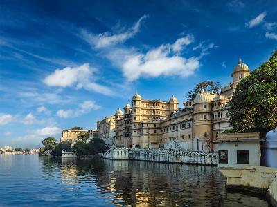Romantic India Luxury Tourism Concept Background - Udaipur City Palace and Lake Pichola. Udaipur, R