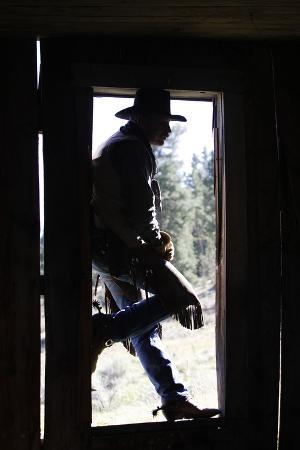 Cowboy Silhouetted in Door Frame