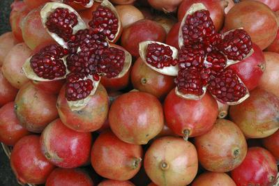 Pomegranate: Opened to Show Seeds Within Sweet Jelly