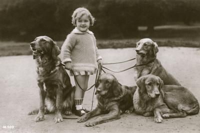 Little Girl and Four Dogs in a Garden