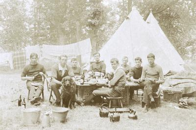 Men Camping with a Dog