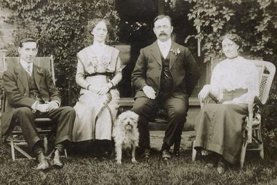Four People and a Dog in a Garden